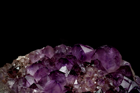 part of mineral purple Amethyst crystal quartz texture background with black isolated background and have some space for write wording