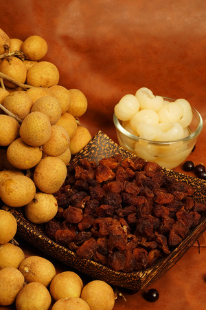 Longan product, dry longan, longan in syrup set with brown tone background Banco de Imagens