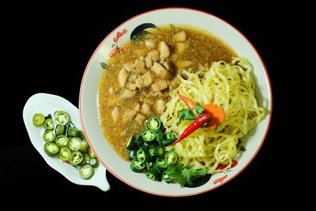 Chicken with sauce over Noodles in Thailand traditional street food Archivio Fotografico - 147143746
