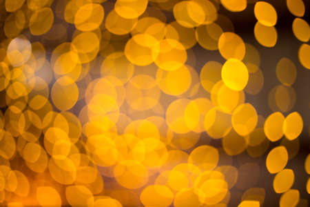 yellow photo: Abstract gold bokeh background circles for Christmas card. Defocused yellow rounds photo Stock Photo