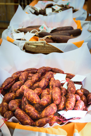 sapid: Sausages in assortment in wattled baskets on white napkins