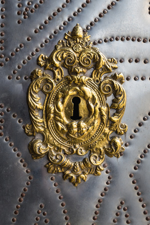 unwelcome: ancient an unusual form a keyhole in a wooden door