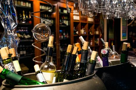 traffic jams: Wine in the bottles closed by traffic jams against wooden brown wine racks