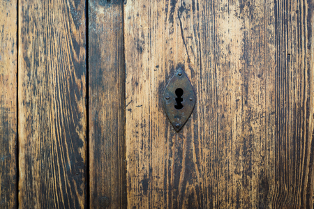 unwelcome: ancient an unusual form of keyhole in a wooden door