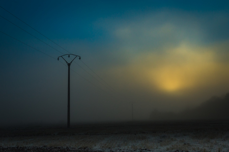 Power line in the early foggy morning.