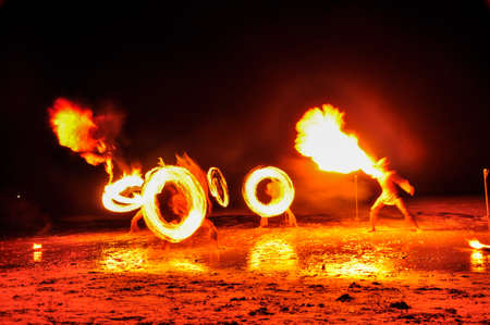 Amazing Fire Show at night on Khoa chang Island, Thailand 免版税图像