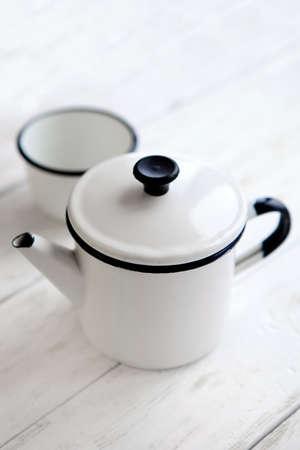 Beautiful retro home enamelware: mugs  and coffee pots, white vintage kitchenware Imagens