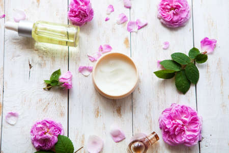 cosmetic creams and rose essence oil with rose petals on white background Spa treatment. Spa massage .top view Flat lay Stock fotó - 81208299