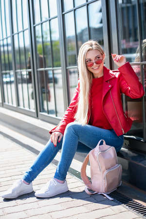 Bright lifestyle fashion portrait of sensual beautiful young woman having fun smiling pretty , natural beauty face,skin care, bright casual trendy sunglasses,bright sexy make up, traveling mood
