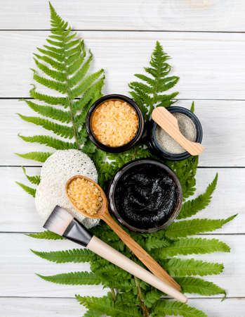 Eco-friendly cosmetics. face mask, scrub and bath salt on fern leaves. natural skincare medical treatment therapy