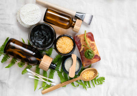 Beauty background with various eco friendly cosmetic and skin care products . lotion, body oil, mask, bath salt handmade soap on linen towel