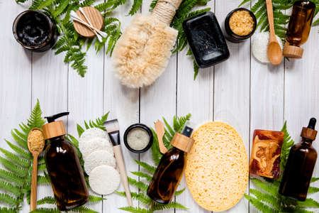Eco-friendly cosmetics and zero waste set for spa on white background top view mock up.skin care products with lotion, body oil, mask, bath salt handmade soap,bamboo brush Imagens