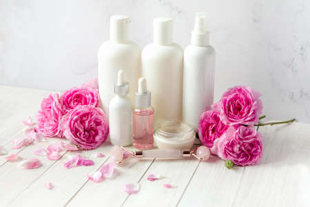 bath and spa with rose flowers. Spa beauty products for body and face home skin care.