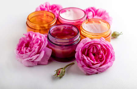 Beauty, skin care.Set of face masks and pink rose on white background. care cosmetics.