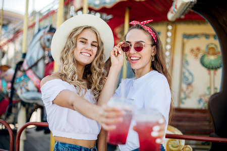Happy brightful positive moments of two stylish girls.Closeup portrait funny joyful attarctive young women having fun, smiling, lovely moments, best friends Imagens