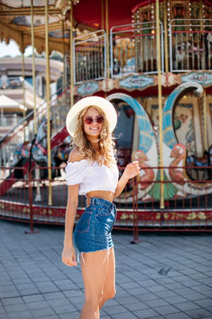 Pretty happy young woman hipster in fashionable clothes. Imagens