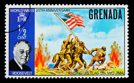 GRENADA - CIRCA 1970: A postage stamp printed in Grenada showing Franklin Roosevelt & Raising The US Flag On Iwo Jima, circa 1970