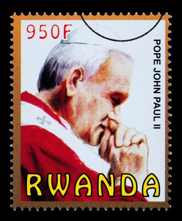 RWANDA - CIRCA 2009: A postage stamp printed in Rwanda showing Pope John Paul II, circa 2009