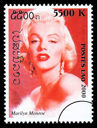 marilyn: LAOS - CIRCA 1999: A postage stamp printed in Laos showing Marilyn Monroe, circa 1999