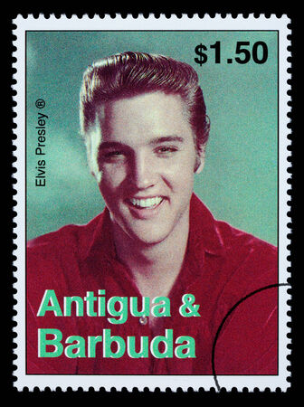 ANTIGUA & BARBUDA - CIRCA 2000: A postage stamp printed in Antigua showing Elvis Presley, circa 2000