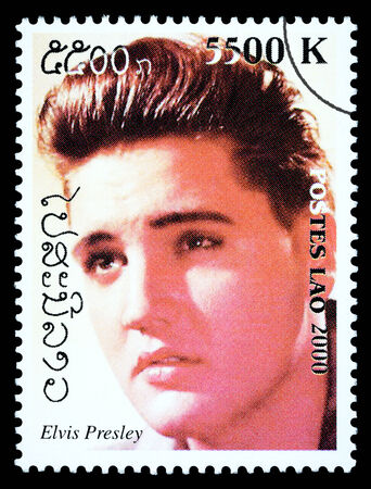 LAOS - CIRCA 1999: A postage stamp printed in Laos showing Elvis Presley, circa 1999