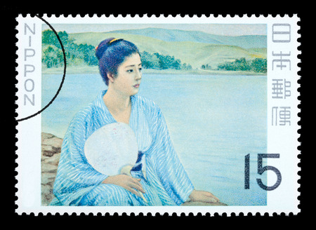 JAPAN - CIRCA 1980: A postage stamp printed in Japan showing a painting of a Japanese woman, circa 1980