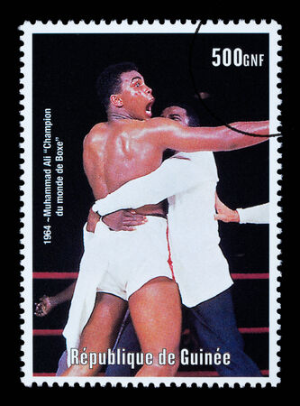 REPUBLIC OF GUINEA - CIRCA 2000: A postage stamp printed in Guinea showing  Muhammad Ali, circa 2000
