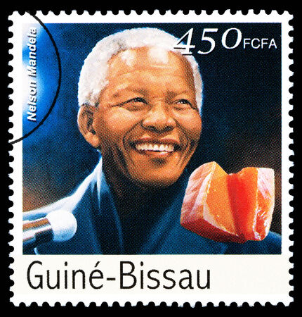 nelson mandela: REPUBLIC OF GUINEA-BISSAU - CIRCA 2000: A postage stamp printed in the Republic of Guinea-Bissau showing Nelson Mandela, circa 2000 Editorial