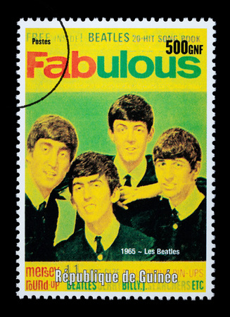 REPUBLIC OF GUINEA - CIRCA 2001: A postage stamp printed in Guinea showing  The Beatles, circa 2001