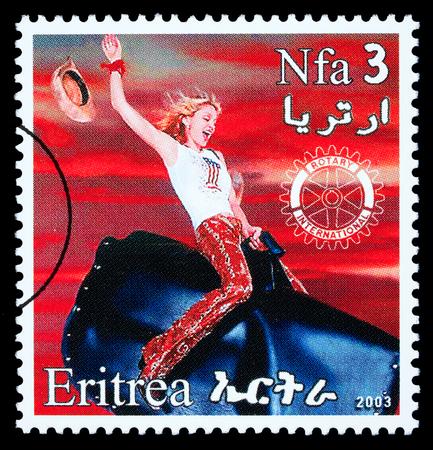 ERITREA - CIRCA 2003: A postage stamp printed in Eritrea showing Madonna Louise Ciccone, circa 2003
