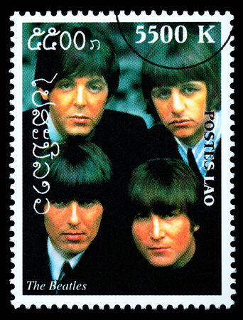 LAOS - CIRCA 2000: A postage stamp printed in Laos showing The Beatles; circa 2000