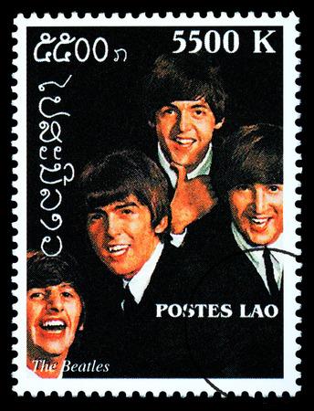 LAOS - CIRCA 2000: A postage stamp printed in Laos showing The Beatles; circa 2000 Redakční