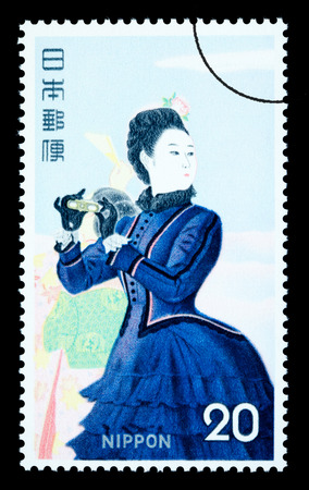 JAPAN - CIRCA 1970: A postage stamp printed in Japan showing a painting of a Japanese woman, circa 1970