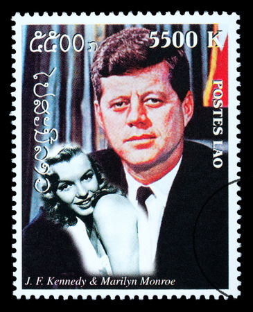 marilyn: LAOS - CIRCA 1999: A postage stamp printed in Laos showing John F. Kennedy, circa 1999