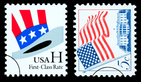 UNITED STATES AMERICA - CIRCA 2002: A pair of postage stamp printed in the USA of the American flag and Uncle Sams Hat, circa 2002