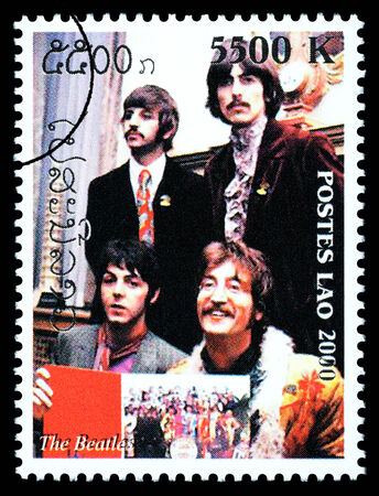 LAOS - CIRCA 2000: A postage stamp printed in Laos showing The Beatles, circa 2000