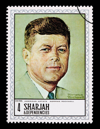 SHARJAH - CIRCA 1984: A postage stamp printed in Sharjah showing John F. Kennedy, circa 1984