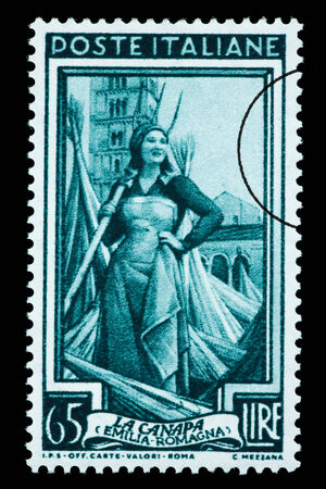 ITALY - CIRCA 1955: A postage stamp printed in Italy of a woman in a hemp field, circa 1955