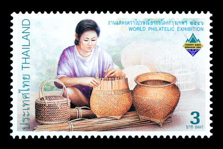 Thailand - Circa 2003: A Thai postage stamp printed in Thailand depicting traditional Thai handicrafts