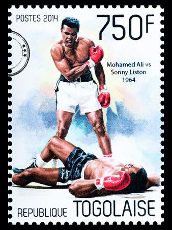 muhammad: NEW YORK, USA - CIRCA 2016: A postage stamp printed in Togo showing Muhammad Ali, circa 2014
