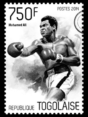 ali: NEW YORK, USA - CIRCA 2016: A postage stamp printed in Togo showing Muhammad Ali, circa 2014