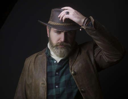 Handsome man in cowboy costume stay in dark. Vampire Hunter. Stock fotó