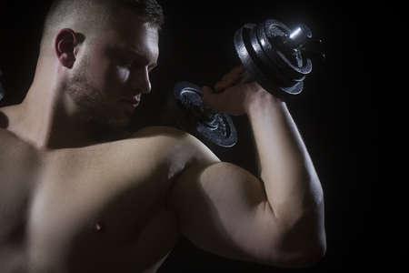 Male flexing his muscles. Sport workout bodybuilding concept.