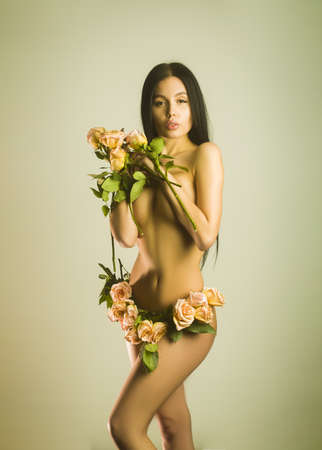 Beautiful Lady in underwear made with blooming flowers rose. Magazine cover.