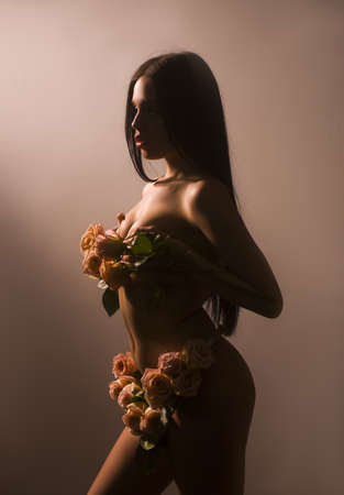 Fashion sexy woman with flowers. Vogue style.