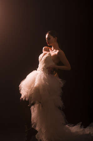 Wearing stunning evening white dress with long gown of tulle.