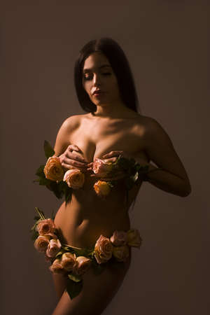 Busty sexy model luxuriating in underwear made with roses.