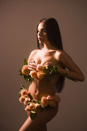 Spring woman. Beauty summer model girl with colorful flowers on body.