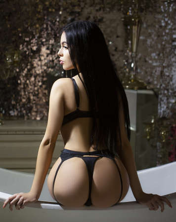 Beauty girl in thong panties, showing sexy ass. Standard-Bild