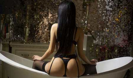 Sexy ass in bathroom. Back view in Thong.
